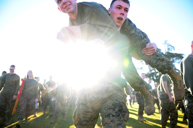 "PRESIDIO OF MONTEREY, Calif. - Even when they are ""goofing-off"" Marines seem to find a way to get some exercise. Marines re-locate between events during the Jan. 13 Field Meet competition."