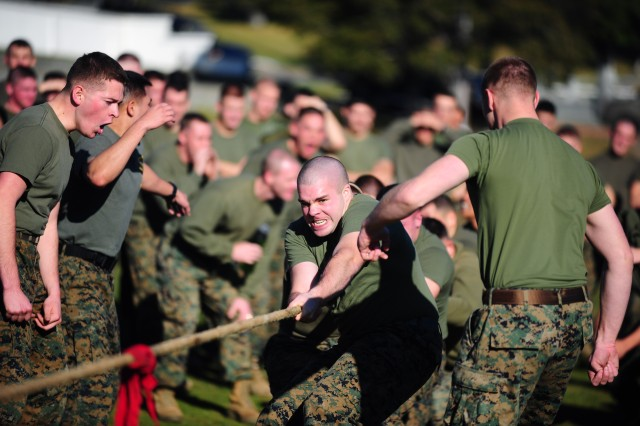 PRESIDIO OF MONTEREY, Calif. - Marines compete in a tug-of-war event on Soldier Field during the Field Meet competition. Like most of the events, the tug-of-war competition was rigged to favor one team and demonstrate the difficulties of overcoming disadvantage.