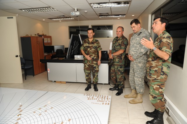 "ARICA, Chile "" Maj. Gen. Simeon G. Trombitas (second from right), the U.S. Army South commander,  tours the Chilean Education and Doctrine Command in Arica, Chile, in December of 2011 along with Col. Jorge Peña (right), the Chilean army Doctrine División commander."