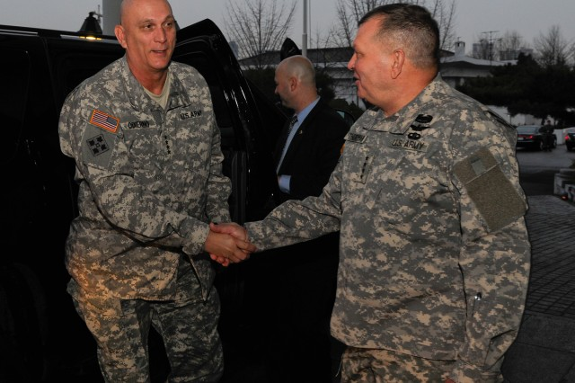 U.S. Army Chief of Staff Gen. Raymond T. Odierno (left) shakes hands with Gen. James D. Thurman, commander of United Nations Command, Combined Forces Command and U.S. Forces Korea, during a visit to South Korea Jan. 20, 2012.