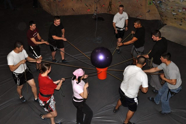 FORT HOOD, Texas--Soldiers with the 1st Battalion, 21st Field Artillery Regiment, 41st Fires Brigade participated in group team-building activities at Boulders Sports Climbing Center in Harker Heights, Texas, during a battalion spiritual fitness training event, Jan. 11. One of the stations was the ball in the bucket were Soldiers had to throw the ball in the air and catch it without the ball touching the ropes or the floor.