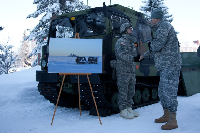 Chief of Staff of the Army Gen. Raymond T. Odierno shakes the hand of Staff Sgt. Tony Rolofson, 84th Engineer Support Company, manning a Small Unit Support Vehicle display Jan. 20, 2012, at U.S. Army Alaska headquarters on Joint Base Elmendorf-Richardson, Alaska.