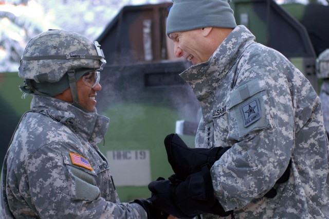 Chief of Staff of the Army Gen. Raymond T. Odierno presents a coin to Spc. Marchal Mitchell, 56th Engineer Company, 6th Engineer Battalion during a Jan. 20, 2012, visit to U.S. Army Alaska Headquarters at Joint Base Elmendorf-Richardson, Alaska.