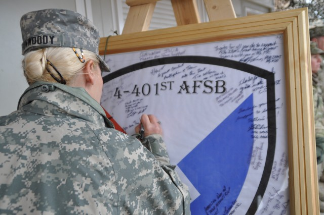 Gen. Ann E. Dunwoody, commanding general of Army Materiel Command, signed the visitor's board at the Army Field Support Battalion Kandahar.  While there she presented Soldiers and Civilians with coins for their superior performance in support of warfighters in Afghanistan. Gen. Dunwoody made the stop in Kandahar as part of a multiple day trip to visit with Soldiers and civilians within the Army Materiel Enterprise.