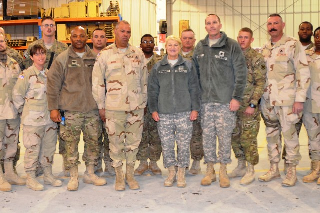 Gen. Ann E. Dunwoody, commanding general, Army Materiel Command (center right), stands with Soldiers, Marines and Department of the Army civilians following a coin presentation. Also shown are Col. Michel M. Russell, Sr., commander, 401st Army Field Support Brigade (front row, third from left), Command Sgt. Maj. Ronald T. Riling ( next to Dunwoody), and Command Sgt. Maj. Ramon C. Caisido, command sergeant major, 401st AFSB (front row, far right).
