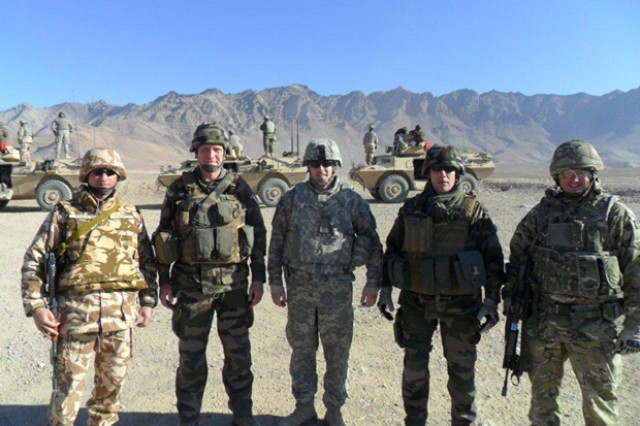 (Left to Right) Lt. Col. Moraru-Apostol, Romanian Army; Lt. Col. Thierry Bourioun, French Army, Armor Branch School senior mentor; Maj. Patrick McFall, U.S. Army, forward deployed representative, product manager, Armored Security Vehicle; Lt. Col. Francoise Marechal, French Armor Branch School deputy; and, Capt. Robin Davies, British Army, Armor Branch School Training Advisory Group.
