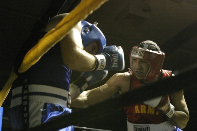 Sgt. Charles Blackwell III, 925th Transportation Detachment, Marana Ariz., lands a punch at Spc. Robert Judge, Redstone Arsenal, Ala., during the heavyweight bout at the 2012 All Army Boxing Championship held at Barnes Field House, Fort Huachuca Ariz., Jan. 21, 2012. Blackwell went on to defeat Judge and will move on to the all Armed Forces Boxing Championship at Camp Pendleton, Calif., beginning Jan. 31, to defend their 20-year Armed Forces Boxing title.