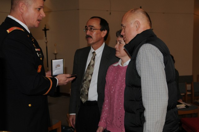 KENT, Wash. - Col. Steve Bullimore (left) presents a Congressional Gold Medal to the family of Mitsuru Hayashi, during a memorial service Jan. 6.  Hayashi was a Japanese-American Soldier and World War II veteran assigned to the 442nd Regimental Combat Team. (Photo by Sgt. Mark Miranda)