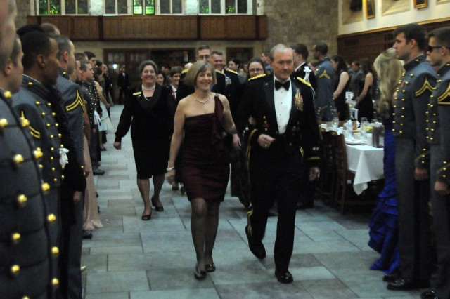 Gen. Martin E. Dempsey, Chairman of the Joint Chiefs of Staff, is accompanied by his wife Deanie into the Cadet Mess for the 500th Night banquet for the Class of 2013. Dempsey, a Class of 1974 graduate and career armor officer, provided the keynote address. As a token of their appreciation for him providing the keynote address, the Class of 2013 cadets  presented Dempsey with a charitable contribution in his name to the Tragedy Assistance Program for Survivors (TAPS).