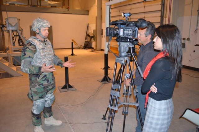 A Naval officer is interviewed by local media regarding his participation in the joint exercise.
