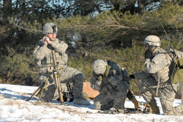 Soldiers from 2nd Battalion, 14th Infantry Regiment, 2nd Brigade Combat Team, provide indirect fire support during a live-fire training exercise Jan. 20 on Fort Drum.