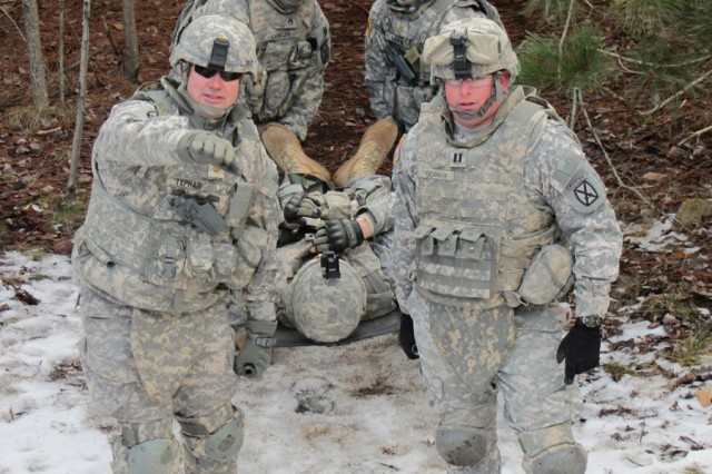 Maj. George Typhair and Cpt. Patrick Gorham from Headquarters and Headquarters Company, 210th Brigade Support Battalion, 2nd Brigade Combat Team lead in a casualty evacuation scenario Jan. 10 while maneuvering through the Medical Simulation Training Center Obstacles Course on Fort Drum.
