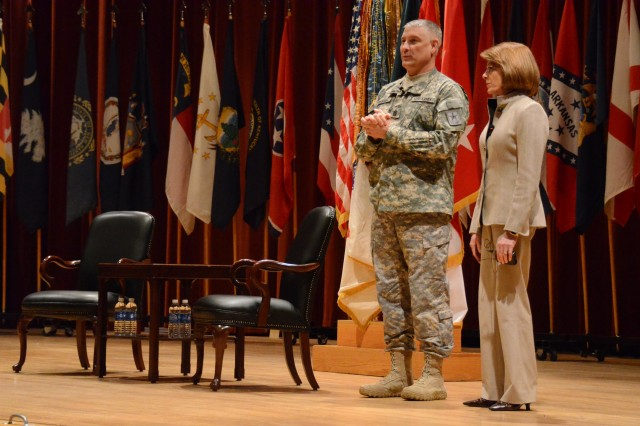 Sgt. Maj. of the Army Raymond Chandler and his wife, Jeanne, address the crowd during Friday's town hall meeting at Fort Jackson, S.C.