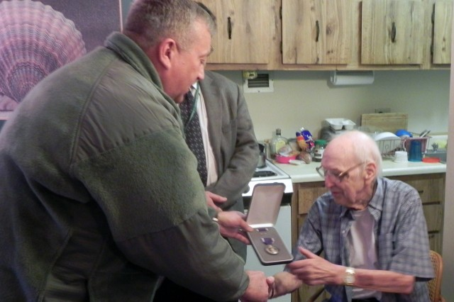 Aaron Narvol, a World War II Veteran, received his Purple Heart medal nearly 70 years after being wounded by enemy fire in the spring of 1942, by Brig. Gen. Bud R. Jameson Jr., commander of the 316th Expeditionary Sustainment Command.  After decades of work on his own, the office of Sen. Robert Casey Jr., was able to locate and process the proper award paperwork. Narvol served as an engineer sergeant in the Pacific Theater and received the Silver Star for his actions of valor during the conflict that day.