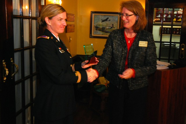 "Chief Warrant Officer 2 Jennifer Hakeman, left, an AH-64 ""Apache"" helicopter pilot with the 1st Bn., 3rd Aviation Regt., 3rd Combat Aviation Bde., receives the Amelia Earhart Achievement Award from Zonta Club of Hilton Head Island President Linda Warnock, during a reception Jan. 19 at the Mighty Eight Air Force Museum of Pooler, Ga."