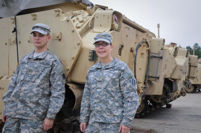 Maj. Julie D'Annunzio (right), 2-3 Brigade Troops Support Battalion, 2nd Heavy Brigade Combat Team, 3rd Infantry Division, poses with fellow Bradley crew member, Pfc. Anthony Langone. D'Annunzio became one of the first females to ever complete Bradley fighting vehicle gunnery, a combat position that is normally a male-only event.