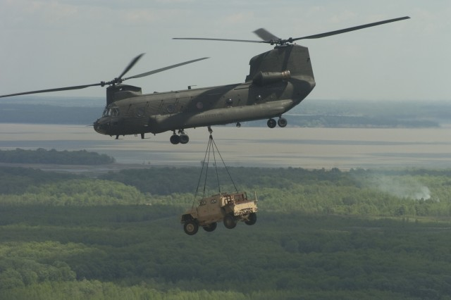 An Army and U.S. Marine Corps' Joint Light Tactical Vehicle team conducts a helicopter sling load transportability test during the Technology Development phase.