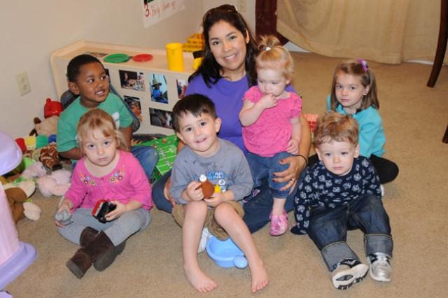 Percillia Villanida, child care provider for FCC, takes care of six children in the children's play room of her home Jan. 24.