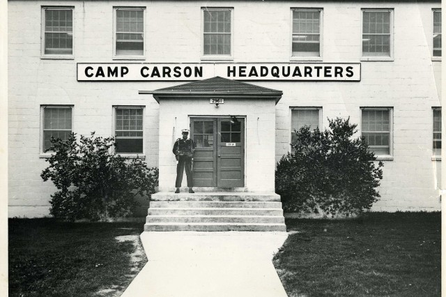 A Soldier stands outside Camp Carson Headquarters in this 1950s-era photograph. Camp Carson became Fort Carson Aug. 27, 1954.