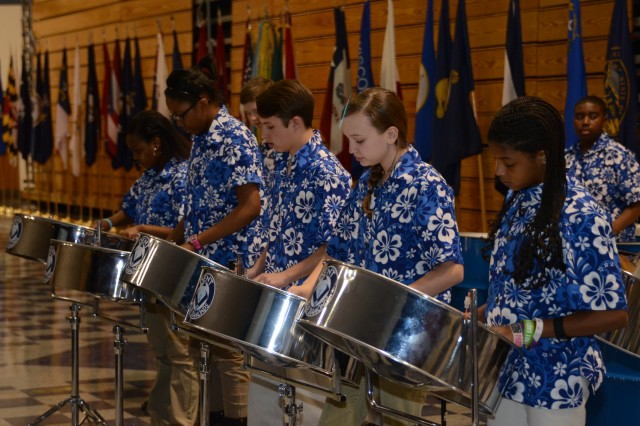 Students with Dent Middle School's Blue Diamond Steel Drum Band perform during the Martin Luther King Jr. celebration Friday at the Solomon Center.