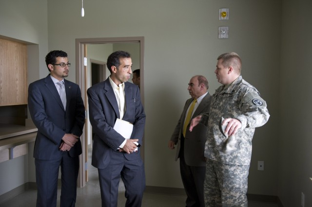 Chief Warrant Officer 2 Michael Henderson gives a tour of a new Warrior Transition Barracks at Fort Hood, Texas, to Ibrahim Ahmed Affat and Ahmed Tijani Zekri, Jan. 25, 2012. Six members of the Libya National Economic Development Board toured facilities in Washington, D.C., and at Fort Hood to learn about rehabilitative programs for wounded troops.