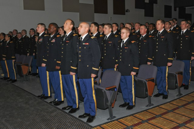 """The U.S. Army's 85 newest officers sing """"The Army Goes Rolling Along"""" during their commissioning ceremony Jan. 26 at Fort Benning, Ga."""