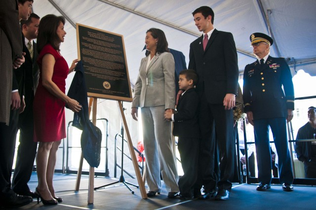 The Soltes family looks on as plaques are unveiled in front of the VA's newest medical facility in Long Beach Calif. Maj. Charles R. Soltes, Jr., was a civil affairs officer and doctor of optometry who was killed in action while rebuilding the medical infrastructure in Mosul, Iraq. The new blind rehabilitation center was dedicated Jan. 25, 2012. (U.S. Army photo by Staff Sgt. Felix R. Fimbres)