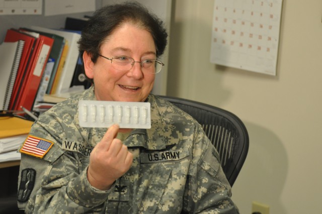 Colonel Rochelle Wasserman, Warrior Transition Battalion surgeon and director of the Warrior Care Clinic, displays a pack of needles used in auricular acupuncture. This treatment, which involves small needles placed in the ears, is one of several new integrative medicinal techniques being explored at the clinic. Other therapies such as hypnosis and electric cranial stimulation are also being offered to combat symptoms such as pain and anxiety. Photo by Heather Clark, Fort Campbell Courier staff.