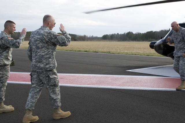 Gen. Robert W. Cone, commanding general of U.S. Army Training and Doctrine Command, and Command Sgt. Maj. Daniel Dailey, command sergeant major of TRADOC, greet Gen. Raymond Odierno, chief of staff of the Army at Felker Army Air Field on Joint Base Langley-Eustis, Va., Jan. 26, 2012. (U.S. Army photo by Staff Sgt. Dana Hill)