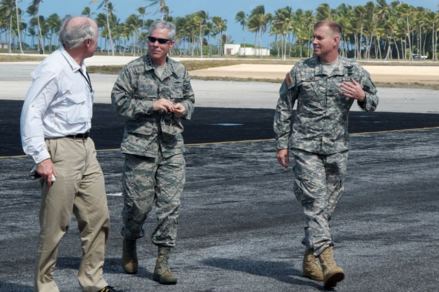 Dr. Grant Stokes, head of Aerospace Dvision at MIT Lincoln Laboratory, left, speaks with Gen. William Shelton, commander of Air Force Space Command, and Col. Joseph Gaines, USAKA/RTS commander, right at the airfield on Roi-namur Jan. 24.