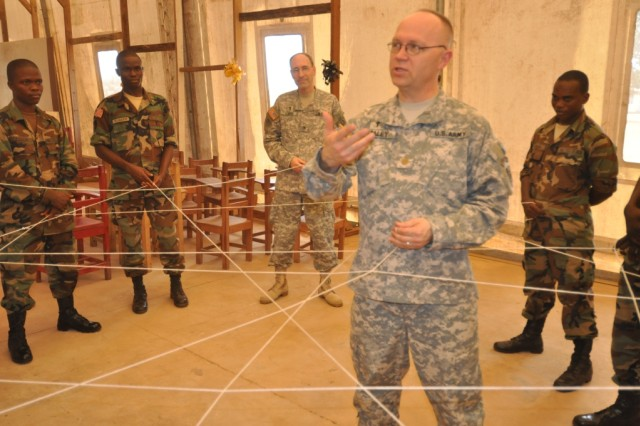 U.S. Army Africa Chaplain Maj. Allen Staley leads the Armed Forces of Liberia chaplain group in a learning exercise.
