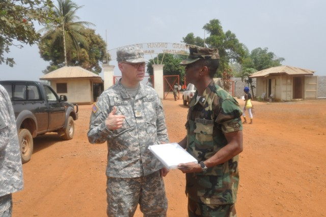 U.S. Army Africa Chaplain Maj. Allen Staley, speaks with Armed Forces of Liberia Chief of Chaplains 1st Lt. Dessaline Allison.