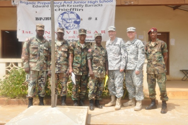 Col. Scottie R. Lloyd, director of personnel in Ecclesiastical Relations for the U.S. Army Chief of Chaplains (third from right) and U.S. Army Chaplain Maj. Allen Staley pose with instructors at a school for children created by the Armed Forces of Liberia chaplains.