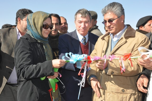 Dr. Suraya Dalil (left), acting Afghan Minister of Health, Brad Hanson, U.S. Department of State Representative, Provincial Reconstruction Team and Daud Shah Saba, Governor of Herat Province cut the ribbon at the Shindand Hospital groundbreaking ceremony, Jan 28.