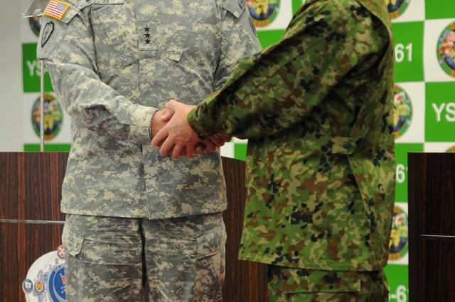 U.S. Army Pacific Commander Lt. Gen. Francis J. Wiercinski and Middle Army Commander of the Japan Ground Self Defense Force Lt. Gen. Ryuichiro Arakawa shake hands during the bilateral press conference Yama Sakura 61 Jan. 30, 2012, at Camp Itami, Japan.