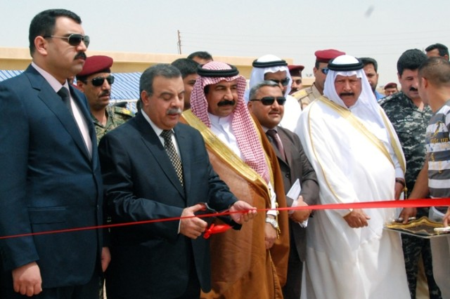 Government officials and representatives from Iraq's Ministry of Municipalities and Public Works cut the ribbon at a ceremony celebrating the facility's completion.
