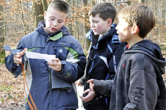 Members of Pack 13's Webelo II den discuss their next move during an orienteering exercise at Boy Scout Troop 107's Klondike Derby in Wiesbaden, Germany, Jan. 14, 2012.