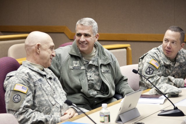 Maj. Gen. Nickolas Justice (left) shares a light moment with Brig. Gen. Jonathan Maddux and Lt. Col. Herb Koehler. Justice, who retires next month, is commander of the U.S. Army Research Development and Engineering Command. Maddux is Program executive office for ammunition and Koehler is Picatinny Arsenal Garrsion Commander.