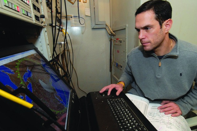 Ryan Armezzani, an electronics mechanic at Tobyhanna Army Depot, verifies operation of the Plan Position Indicator of an AN/TPS-63B Medium Range Surveillance Radar 'hot mock up'.  The mock up is a radar system that will be used to test TPS-63B components.  Armezzani works in the depot's Intelligence, Surveillance and Reconnaissance Directorate.