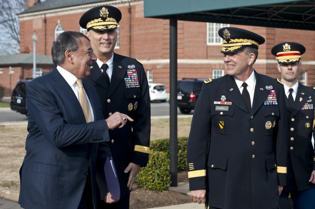 Defense Secretary Leon E. Panetta speaks with Army Vice Chief of Staff Gen. Peter W. Chiarelli, right, and Army Chief of Staff Gen. Raymond T. Odierno before Chiarelli's retirement ceremony on Joint Base Myer-Henderson Hall in Arlington, Va., Jan. 31, 2012.