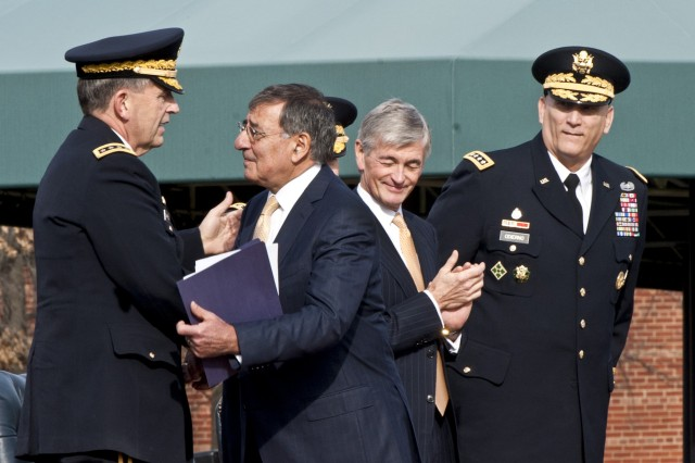 Defense Secretary Leon E. Panetta congratulates Army Vice Chief of Staff Gen. Peter W. Chiarelli during his retirement ceremony on Joint Base Myer-Henderson Hall in Arlington, Va., Jan. 31, 2012. Army Secretary John M. McHugh and Army Chief of Staff Gen. Raymond T. Odierno look on.