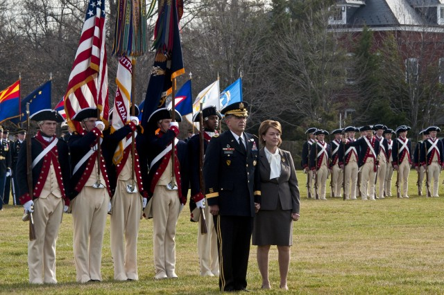 Army Vice Chief of Staff Gen. Peter W. Chiarelli and his wife, Beth, stand before the Continental Color Guard during his retirement ceremony on Joint Base Myer-Henderson Hall in Arlington, Va., Jan. 31, 2012.