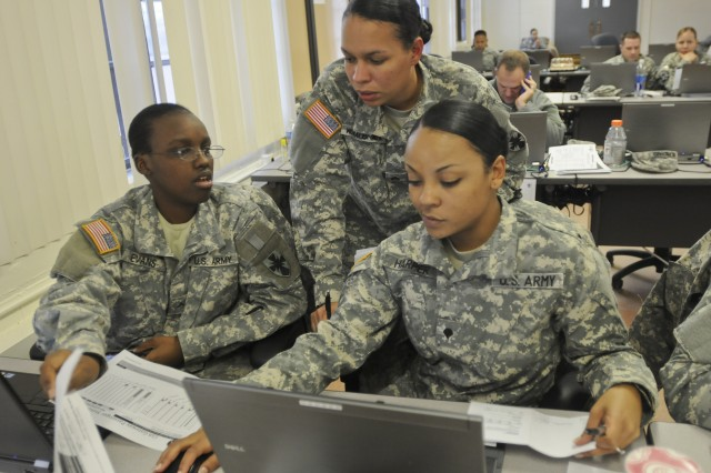 """FORT DEVENS, Mass. -- During Silver Scimitar 2012, Soldiers from the 8th Human Resources Sustainment Center, an active duty unit from Ft. Shafter, Hawaii, practiced their skills in a scenario-based exercise to test their ability to track troop movements and coordinate information with other teams. Pvt. Jakeisha Evans (left), Staff Sgt. Sara Morales-Smith (center), and Spc. Cheryl Harper (right) are part of the Replacement, Staging and Onward Movement teams, or RSOs. They provide visibility and analysis to monitor and assist the flow of troops in a combat theater, making sure Soldiers can get to where they're going in country. """"If they are coming in or going out, we monitor the traffic to make sure they are getting where they're supposed to be because, sometimes, if we don't monitor that, they will get lost in the system,"""" said Lt. Col. Priscella Lewis, RSO Division Chief, 8th HRSC. (Photo by Sgt. David Turner, 214th Mobile Public Affairs Detachment)"""
