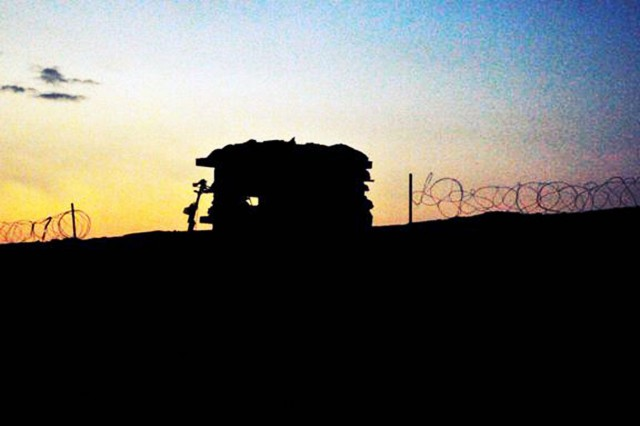 Sunrise at a guard position on a forward operating base in southern Kandahar province, Afghanistan.