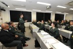 Co-op members brief English students at Camp Kodaira