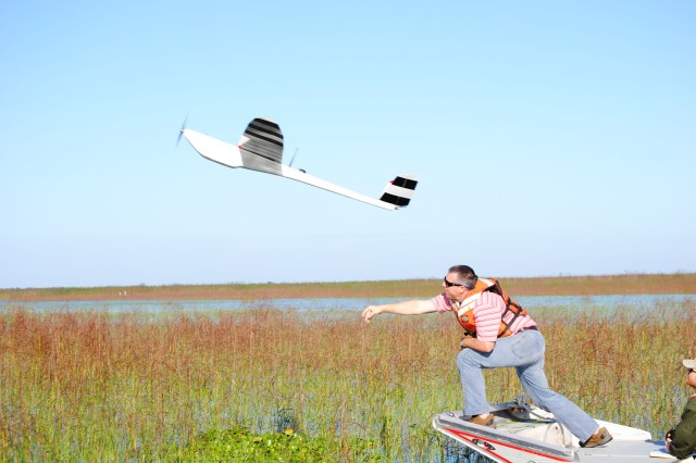 With a mighty heave, Damon Wolfe, geodesist with the U.S. Army Corps of Engineers Jacksonville District, launches the NOVA Unmanned Aerial Vehicle on a flight over Lake Okeechobee.  The Corps used photos from the UAV to track the progress of various plant species at the lake.
