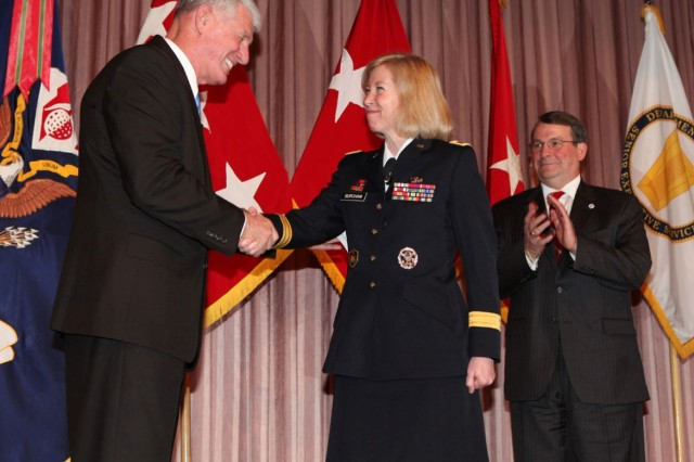 Retired Lt. Gen. Robert Van Antwerp, former U.S. Army Corps of Engineers chief of engineers, congratulates Brig. Gen. Margaret W. Burcham during her promotion ceremony at the headquarters in Washington, D.C., Jan. 27, 2012. Burcham is the Army Corp of Engineers' first female general officer. Last September, Burcham became the first woman selected to command a Corps of Engineers division when she took command of the Great Lakes and Ohio River Division located in Cincinnati, Ohio.