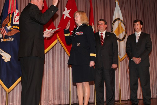 Retired Lt. Gen. Robert Van Antwerp, former U.S. Army Corps of Engineers chief of engineers, administers the oath of office to Brig. Gen. Margaret W. Burcham during her promotion ceremony at the headquarters in Washington, D.C., Jan. 27, 2012. Burcham is the Army Corp of Engineers' first female general officer. Last September, Burcham became the first woman selected to command a Corps of Engineers division when she took command of the Great Lakes and Ohio River Division located in Cincinnati, Ohio.
