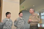 Soldiers talk to Marine Sgt. Maj. Bryan Battaglia, the Senior Enlisted Advisor to the Joint Chiefs of Staff.