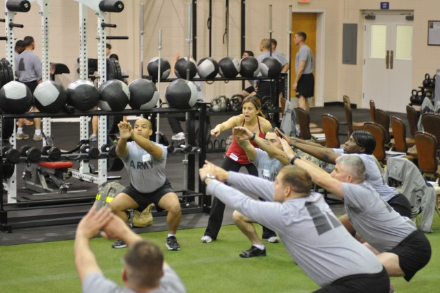 A group of Marne Soldiers learn how to correctly do the front squat during a CrossFit certification at the Caro Fitness Center (CrossFit Fort Stewart) on from Jan. 31 to Feb. 1, 2012.